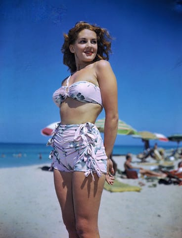 Frances Vorne Modeling Bathing Suit While Standing and Smiling