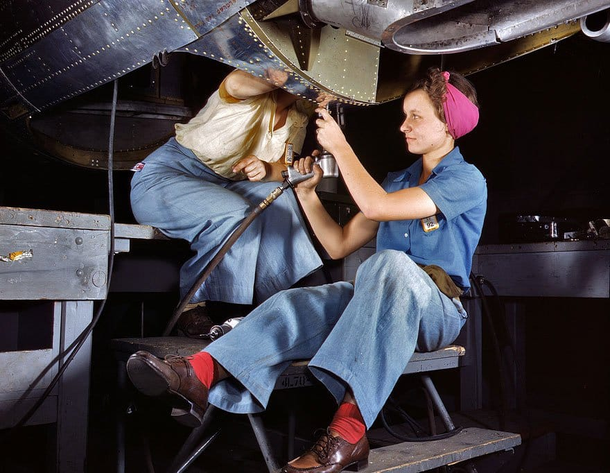 Color photos of women in WWII - Rosie working on airplane