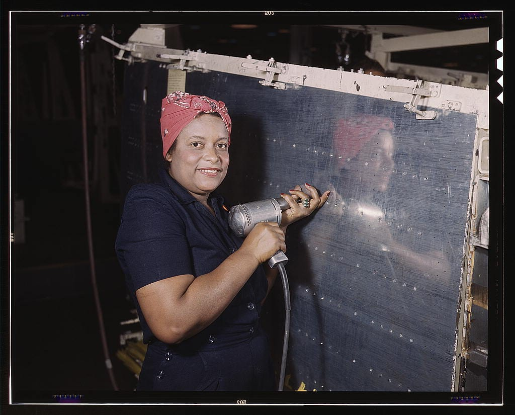 operating-a-hand-drill-at-vultee-nashville-woman-is-working