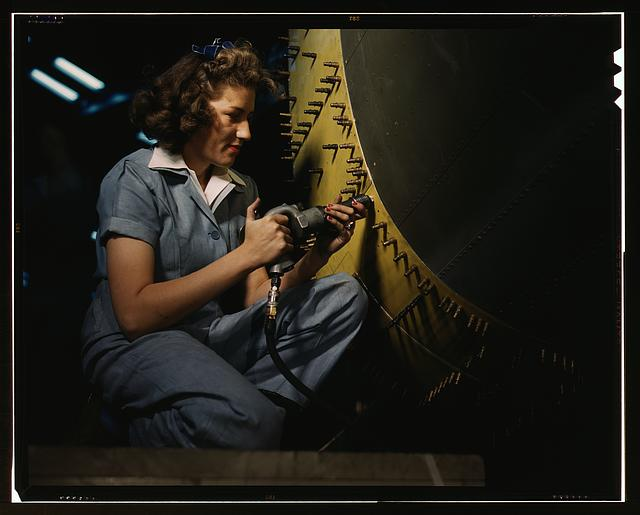 Rosie the Riveter working on a Consolidated B-24 bomber
