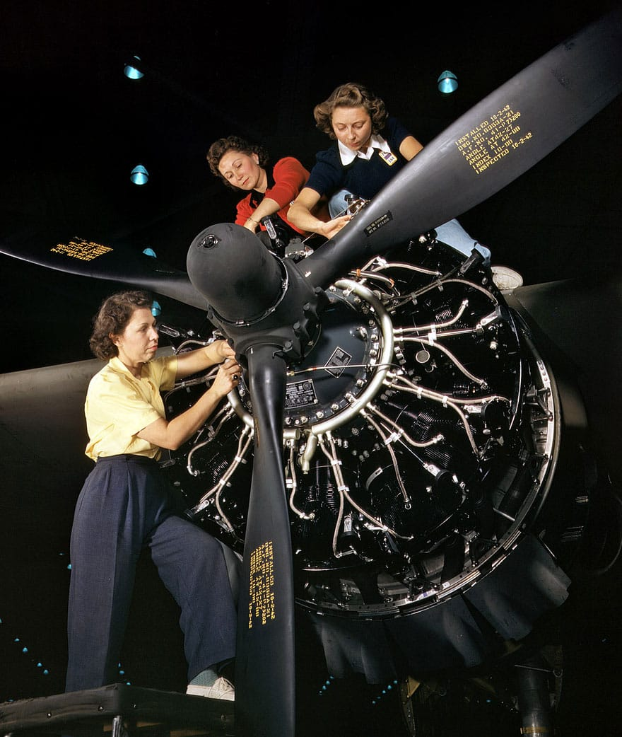 Women working on C-47 engine
