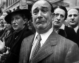 World War II Today: June 14 - French civilian weeping as German soldiers marched into Paris, France, 14 Jun 1940.