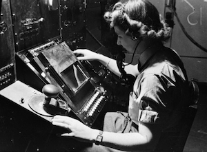World War II Today: June 18 - WAAF radar operator Denise Miley plotting aircraft on the CRT (cathode ray tube) of an RF7 Receiver in the Receiver Room at Bawdsey Chain Home Station (Imperial War Museum)