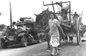 World War II Today: June 19 - French refugees on a road near Gien, France, 19 Jun 1940.