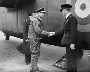 World War II Today: August 25 - The Duke of Kent shakes hands with a BOAC pilot as he boards a Liberator of Ferry Command, Prestwick, Scotland, 1941-43. (Imperial War Museum)