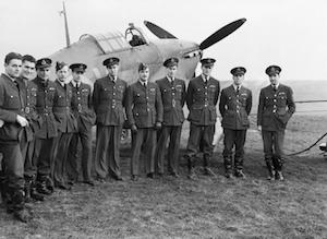 World War II Today: August 26 - Pilots of No. 1 Squadron RCAF with one of their Hawker Hurricanes at Prestwick, Scotland, 30 October 1940. (Imperial War Museum)