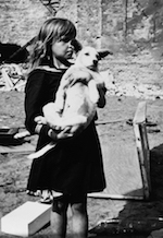 World War II Today: September 8 - Girl holding her dog in devastated Warsaw, Poland, 5 September 1939 (US Holocaust Museum)