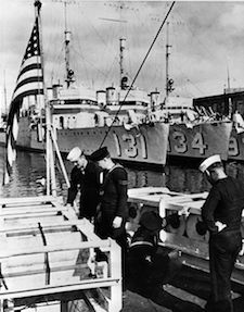 World War II Today: September 2 -Royal Navy and US Navy sailors inspect depth charges aboard Wickes-class destroyers in 1940. In the background are USS Buchanan (DD-131), and USS Crowninshield (DD-134). On 9 September 1940 both were transferred to the Royal Navy. (Library of Congress)