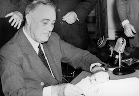 World War II Today: September 16 - President Roosevelt signs the Selective Service Training and Service Act on Sept. 16, 1940 (US Government photo)