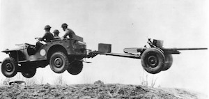 World War II Today: September 23 - Bantam jeep, towing a 37 mm Gun M3 piece, jumping over a small hill, New River, NC, 1941 (Library of Congress)
