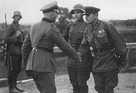 World War II Today: September 28 - German and Soviet officers shaking hands, Poland, late September 1939