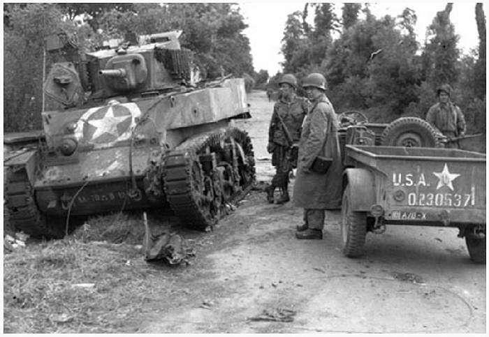 The tank at Dead Man's Corner on the Saint Côme-du-Mont to Carentan road