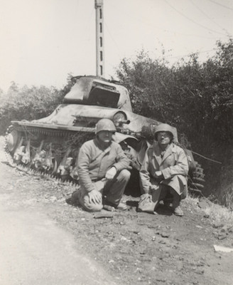 Gi's in front of knocked out tanks