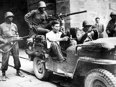 World War II Today: October 15 - Soldiers of US 92nd Infantry Division with German prisoner captured in civilian clothes, Lucca, Italy, September 1944