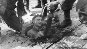 World War II Today: October 2 - Polish insurgent fighter surrendering from the sewers under Warsaw, 27 September 1944 (German Federal Archive. Photographer: August Ahrens, Bild 146-1994-054-30)