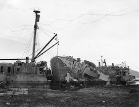 World War II Today: October 9 - USS Ocelot aground in Buckner Bay, Okinawa, with her stern severed by USS Nestor after Typhoon Louise ravaged that port 9 October 1945. Nestor's bow is in the center of this photo. (US Naval History & Heritage Command)