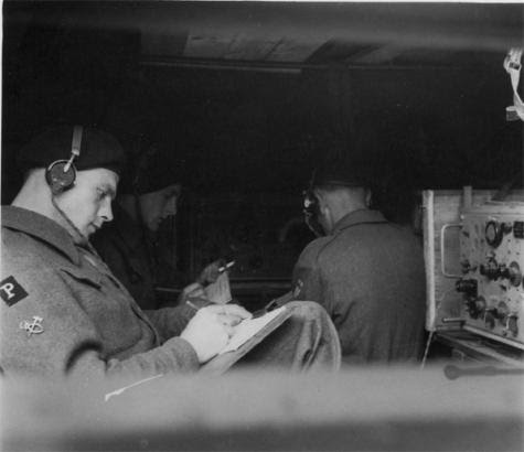 Phantom signal and coding staff at work inside a scout patrol car