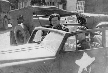 Niven and a Royal Engineers officer in a commandeered car in France
