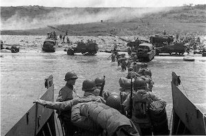 Soldiers and vehicles coming ashore on Omaha beach on D-Day