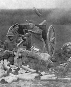 American soldiers manning a 75mm gun on the first day of the Saint-Mihiel Offensive. An ejected shell casing can be seen flying through the air.