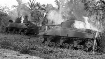 Two Shermans burning on the Pacific island of Guam