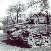 A Sherman (Easy Eight version) with sandbags for additional protection