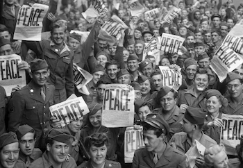 WWII Points - U.S. soldier in Paris celebrating Japan's surrender