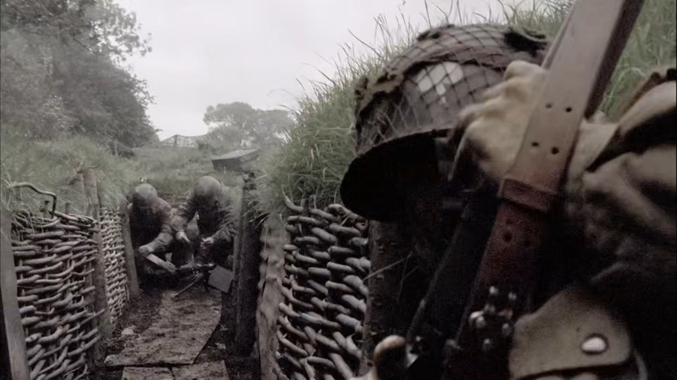 Brécourt Manor Assault -  Shot from Band of Brothers: Winters spotting the German machine gun being set up to prevent American advance beyond the first gun.