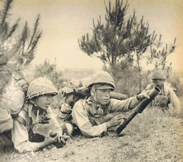 Japanese soldiers with a grenade launcher during the Zhejiang-Jiangxi campaign launched after the raid
