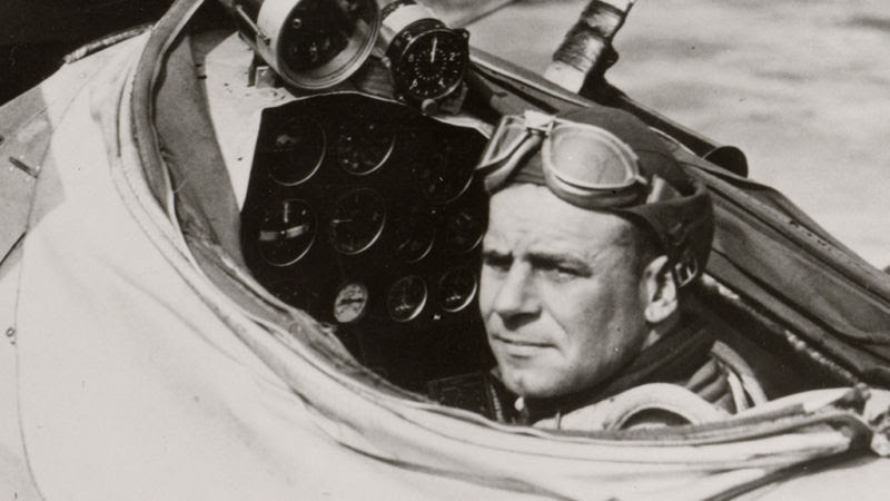A young James Doolittle preparing for his historic blind flight in 1929. The canvas hood around the cockpit was pulled close during the attempt to make sure he only relied on his instruments.