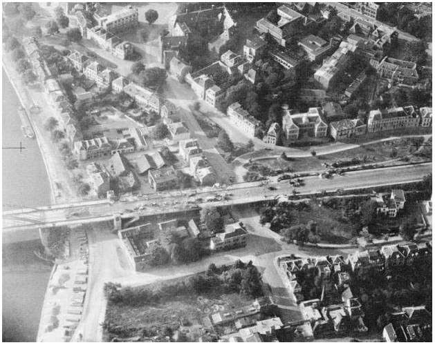 "The final bridge in Operation Market Garden: The northern end of Arnhem Bridge, the famous ""Bridge Too Far,"" with destroyed German vehicles along the road. The very end of the bridge itself can be seen on the left."