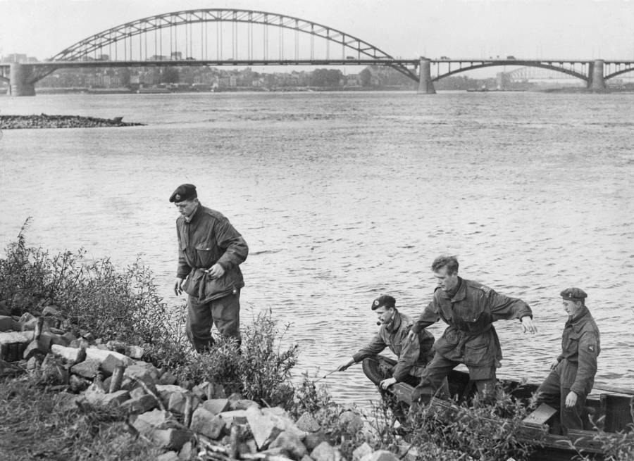 Four British paratroopers at the end of a daring escape. They were captured at Arnhem Bridge but got away in a rowboat and made it back to friendly troops.