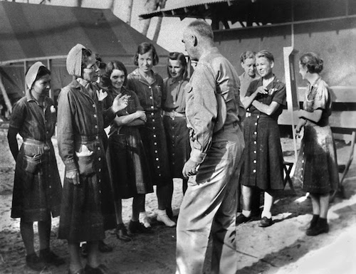 Los Baños Raid – The US Navy nurses imprisoned at the camp, talking with Admiral Thomas Kinkaid shortly after their liberation