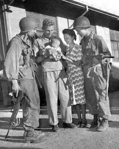 A rescued family with two of their liberators, photographed later on the same day